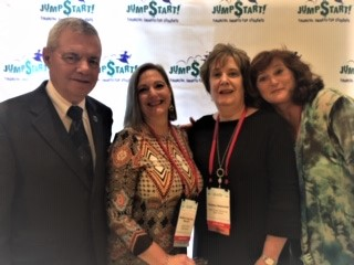 AFDICA President Selby with three of the teachers we sponsored.